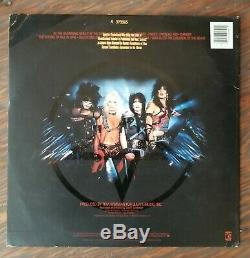 MOTLEY CRUE signed by all 4 SHOUT AT THE DEVIL white label gold stamp promo